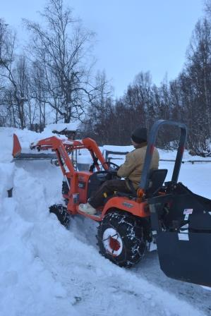 Pete clearing snow from the  arena