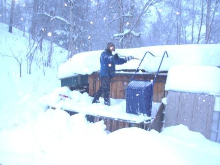 Pete shoveling off horse shed roof