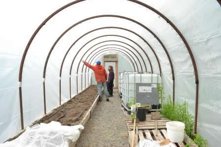 Karen's hoop house made from old cable spools
